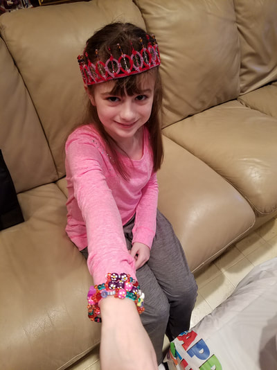 The happy birthday girl with her bracelets that she made herself!