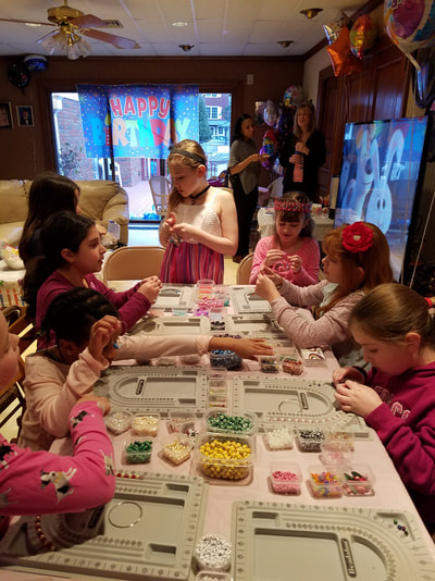 All the girls were very happy to be making their own jewelry at this birthday party.
